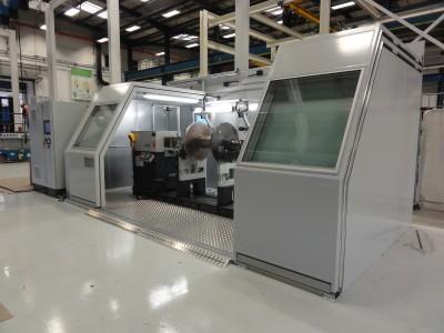 Horizontal balancing machine enclosure with machinery