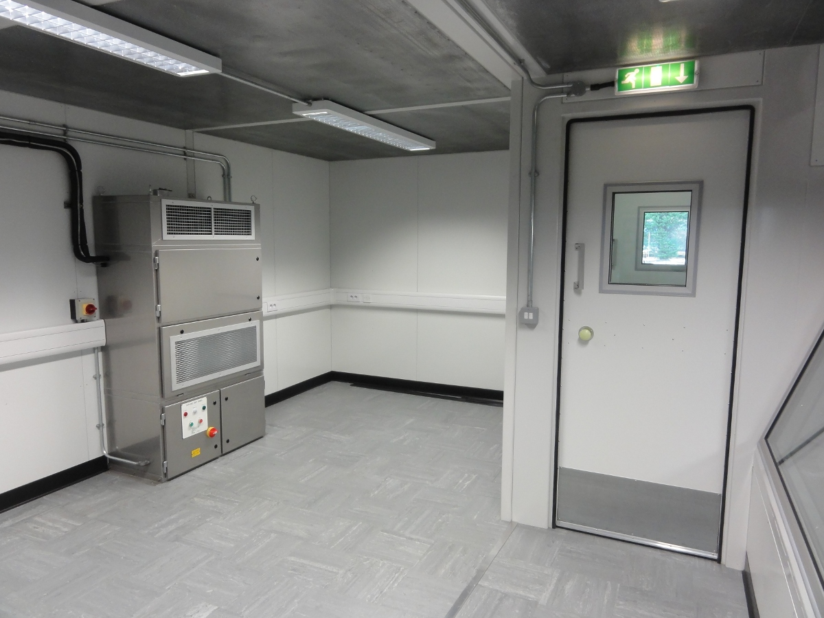 control room interior showing airconditioning and access door