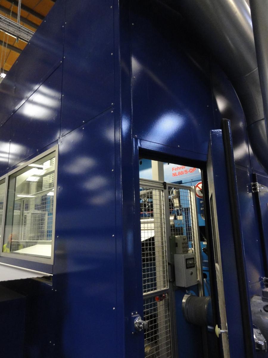 open acoustic door showing machinery