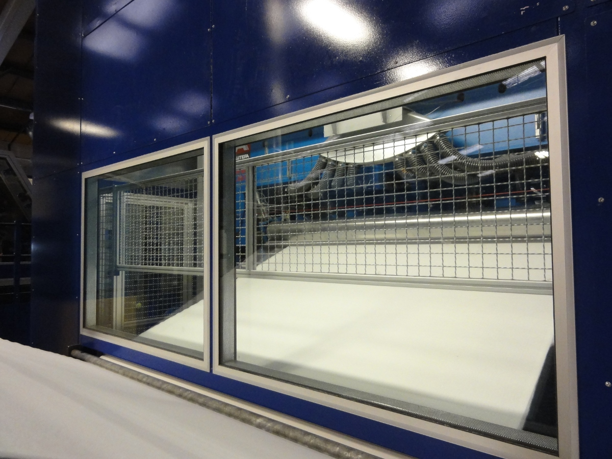 Window detail and feed access for needle loom