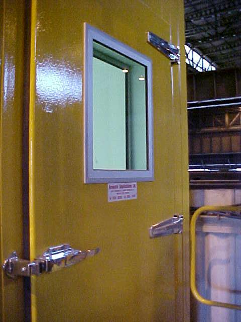 Acoustic enclosure door